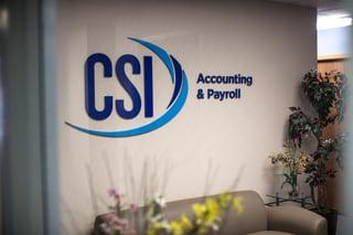 CSI Accounting & Payroll logo on office wall