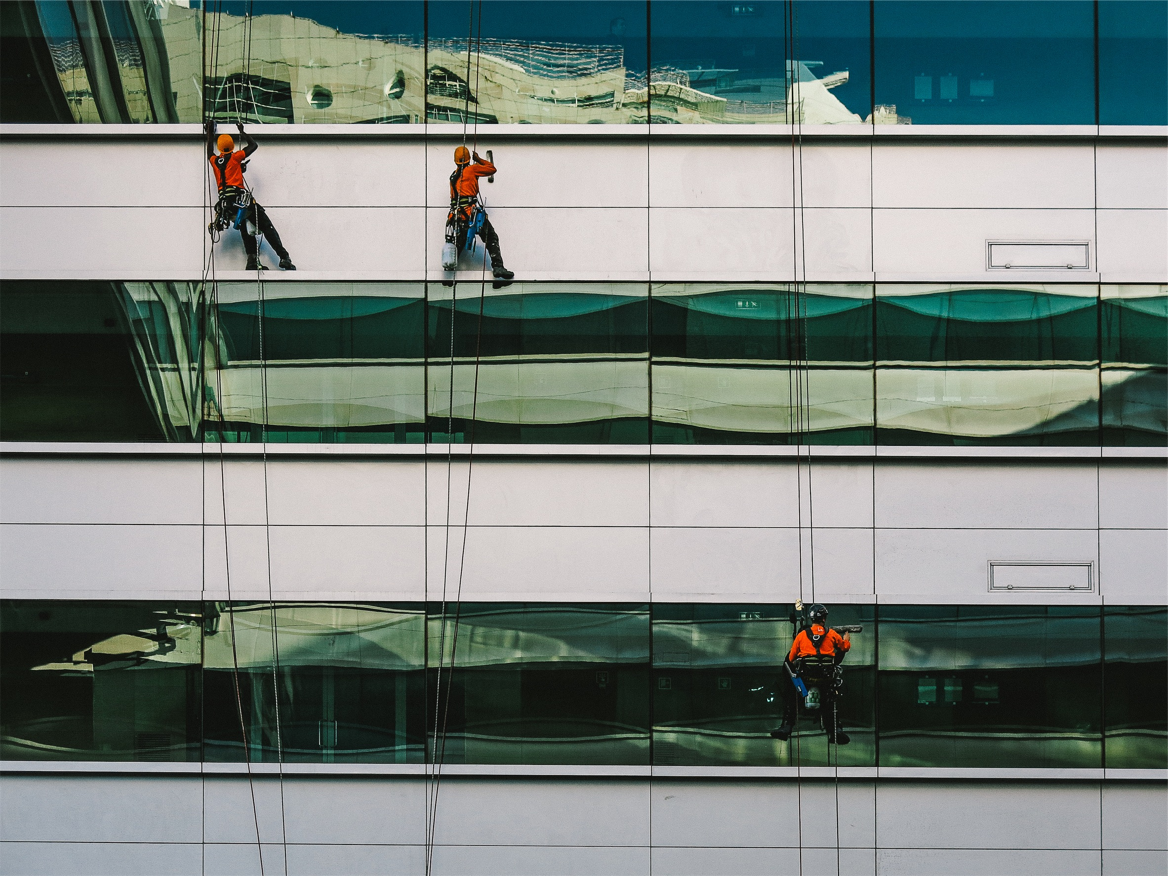 window washers on the side of a building